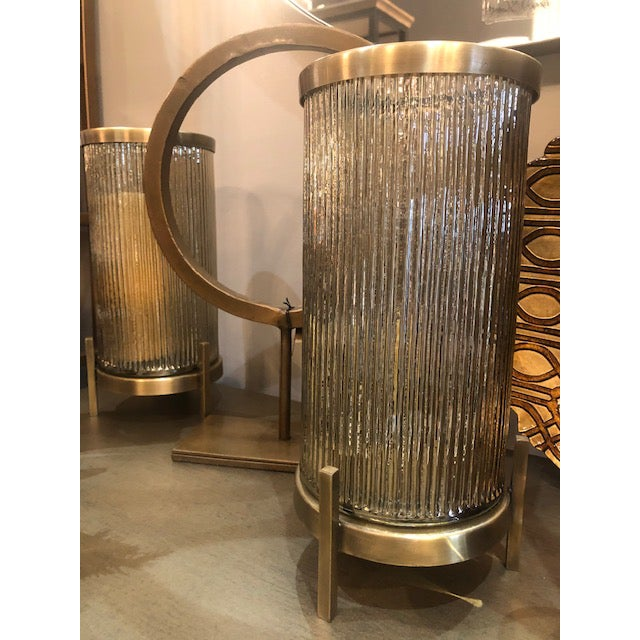 Add some beautiful fresh florals or candles in this dazzling linear glass pattern hurricane. Designed with glass vases...