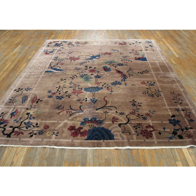 Antique Art Deco Chinese Rug with an ivory background and patterned border.