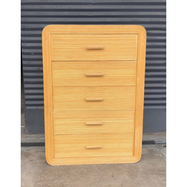 Vintage pencil reed rattan chest of drawers in the style of Gabriella Crespi. A spiraling round design on top that...