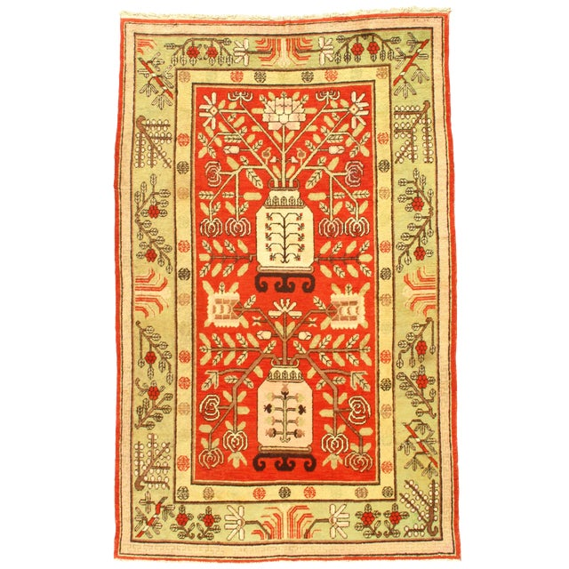 Early 20th Century Antique Khotan Wool Rug - 5′6″ × 8′10″ For Sale