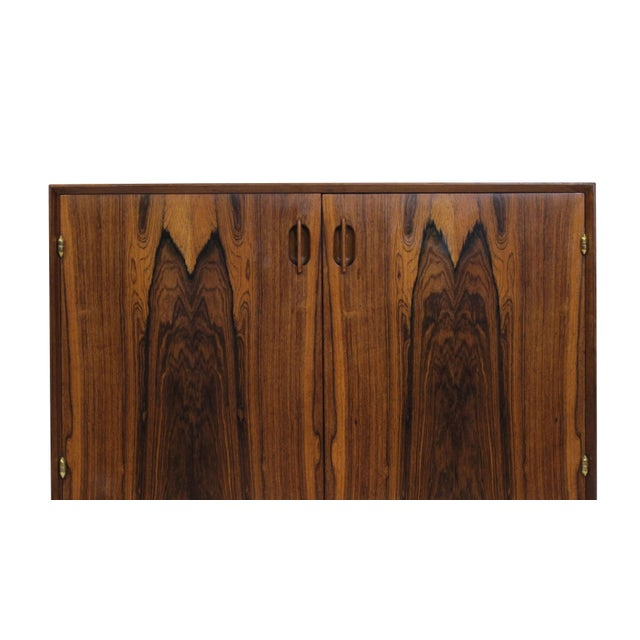 Finely crafted Brazilian rosewood cabinet with mitered corners and dynamic book-matched grain on the doors, bullet-shaped...