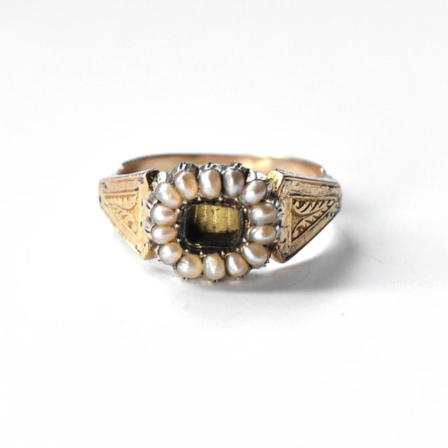 A Lover's Eye portrait in an authentic Victorian gold and seed pearl ring, with the central painting personalized from the...