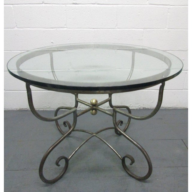 Italian wrought iron centre table. Has round bronze accents. Gueridons table, occasional table. Can be used in or outdoors.