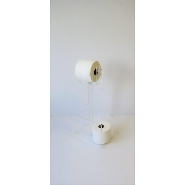 """A 1970s modern magazine holder rack and toilet tissue holder combination, circa 1970s-1980s. Piece measures: 6.25"""" D x 10""""..."""