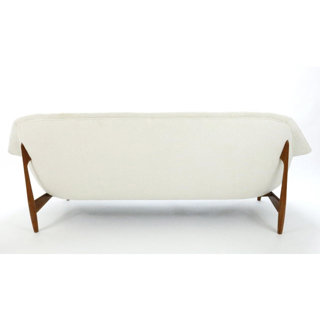 In 1957, IB Kofod-Larsen designed this elegant sofa for Carlo Gahrn, who produced it for only a brief period. The...