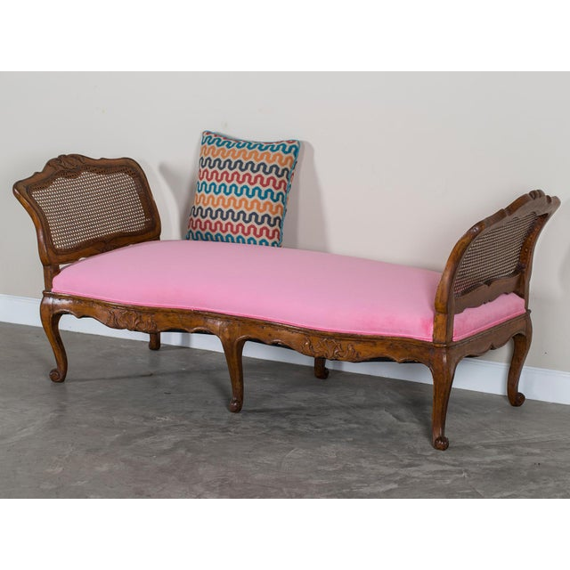 "This elegant Louis XV period antique French walnut daybed circa 1760 has a seat height of 19"" making it extremely..."