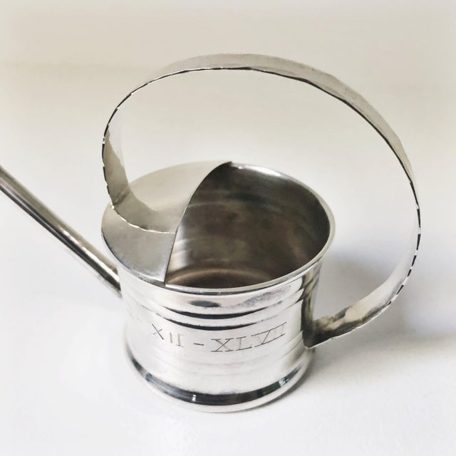 A vintage mid century sterling silver vermouth dripper/sprinkler in the shape of a watering can, made by Cartier. In...