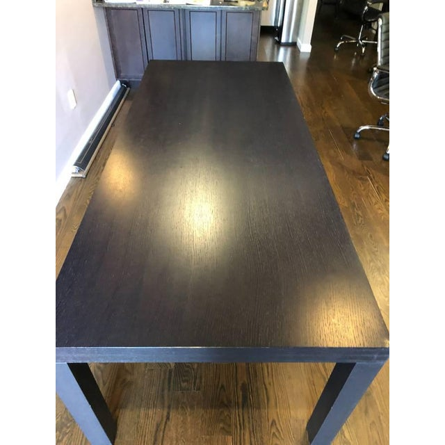 Ligne Roset contemporary dining table, also makes a great conference table. Rectangle solid wood table, finished in a dark...