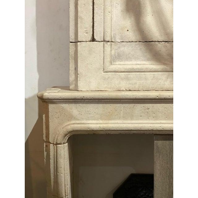 """Louis XIV limestone mantel from France, circa 1880 Measurements: 118"""" H x 24"""" D x 55"""" W Firebox: 43"""" H x 38"""" W."""
