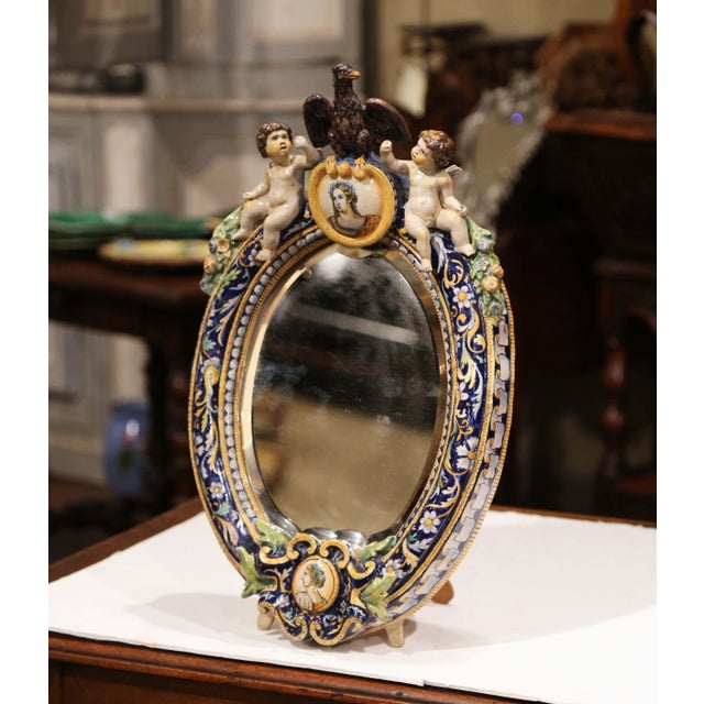 Decorate a counter with this elegant free standing ceramic table mirror. Crafted in France, circa 1860, the colorful...