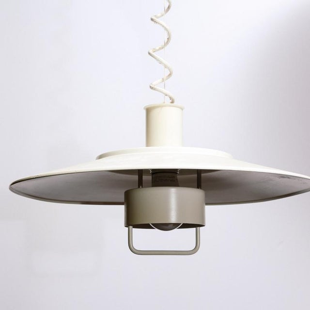 Vintage height-adjustable hanging lamp by Lyfa, Denmark. In the style of Louis Poulsen.
