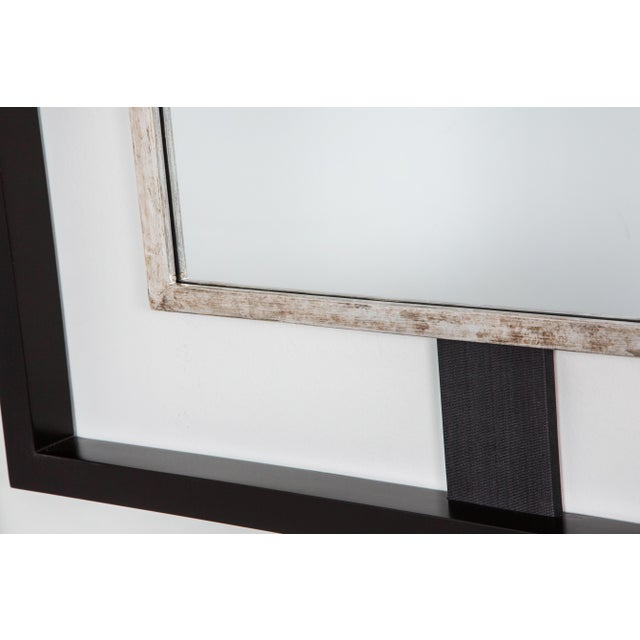 Paul Marra Negative Space mirror shown in ebony stained outer frame and distressed silver inner frame, dark gray-black...