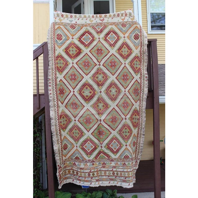beautiful red and green flat weave Turkish cicim rug. Each vintage rug/runner is unique. Variations in color and texture...