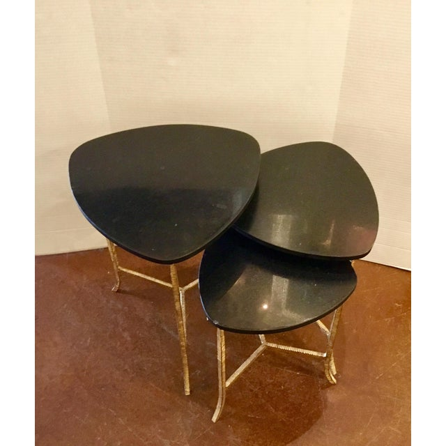 Original Retail $2100, Stylish modern set of three Connor Nesting Tables by: Arteriors, black stone tops with brass...