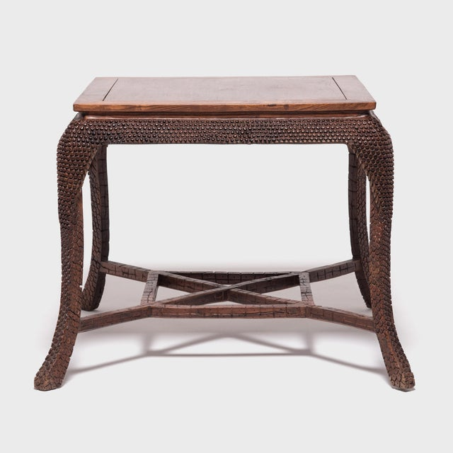 This early 20th century tea table and stools were carved of Huanghuali, or yellow rosewood, a precious and revered...