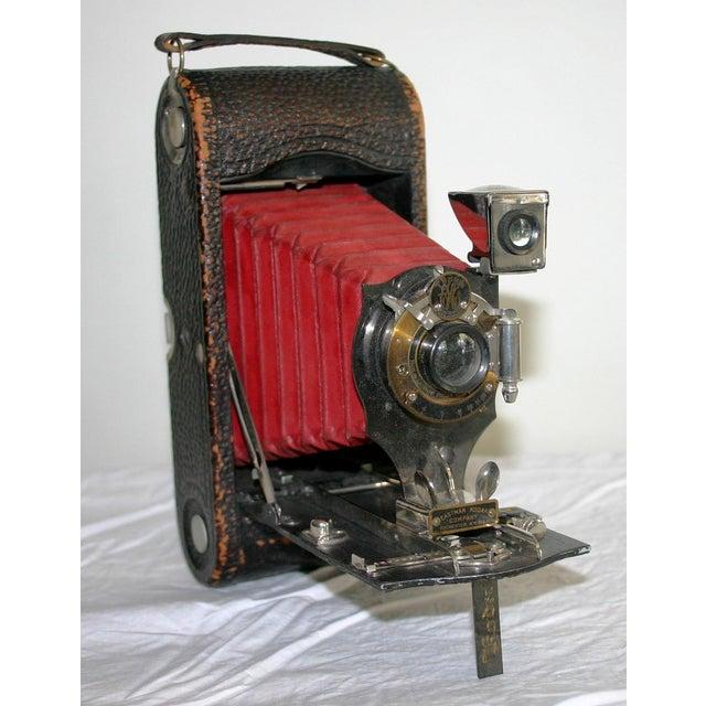 Eastman Kodak folding black leather camera with rare striking red bellows. Circa 1910. Marked Eastman Kodak, Rochester,...