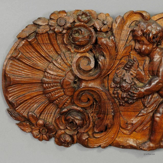 a lovely wooden wall application with cherubs and blossoms. handcarved circa 1920 in germany. accessoires, antique carved...