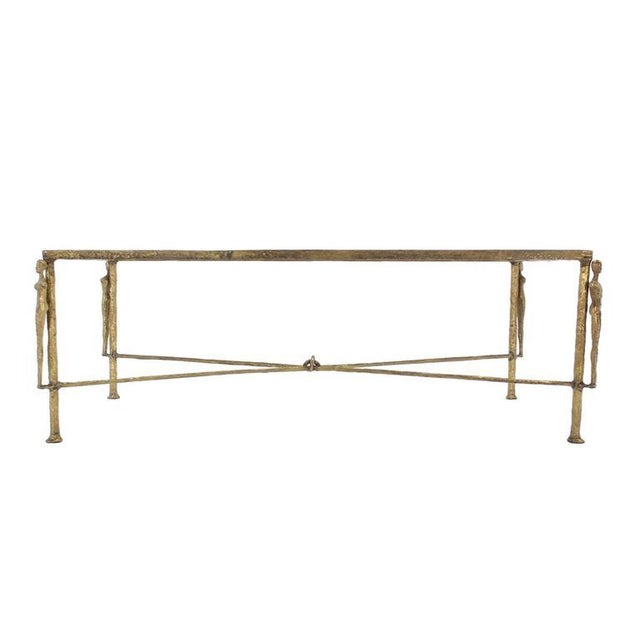 Nice X-base figural base coffee table in style of Giocometti. Very nice table for a large living room or hall.