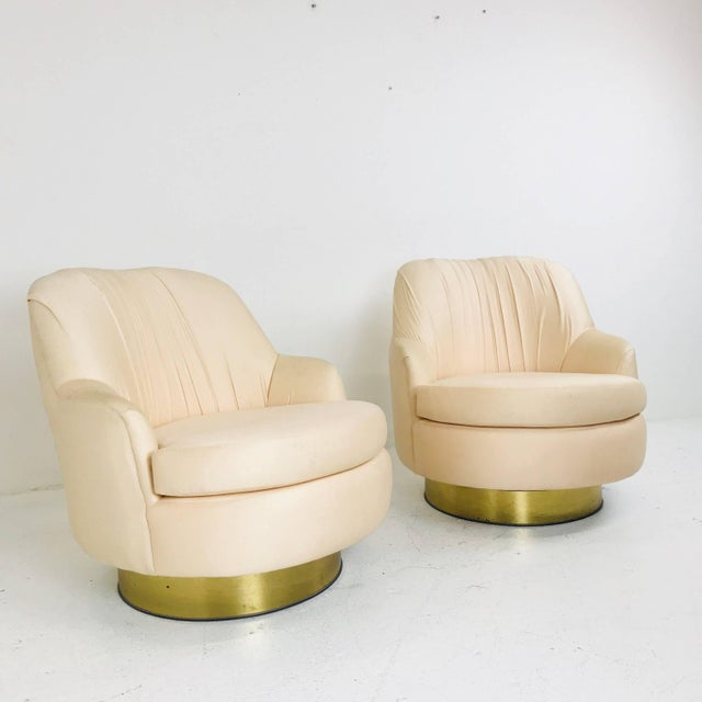 Pair of vintage peach Milo Baughman swivel chairs. Upholstery is in good condition but new upholstery is recommended....