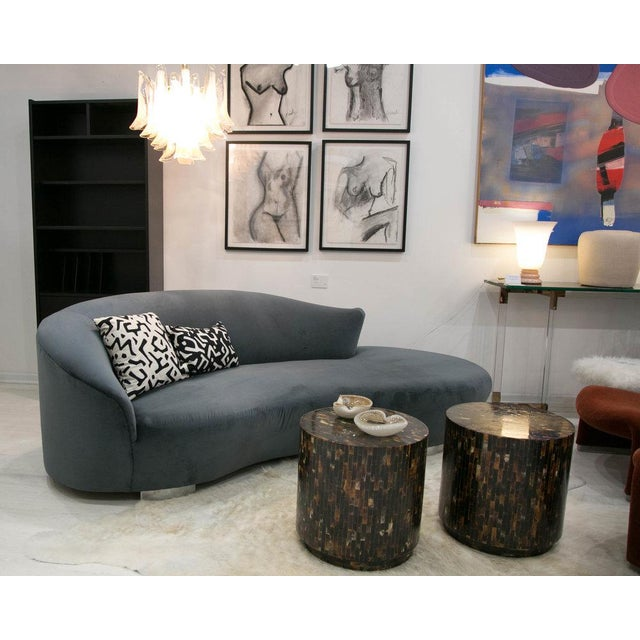 This gorgeous curved sofa in a coveted design has been fully restored in a deep slate blue velvet. The fabric features a...