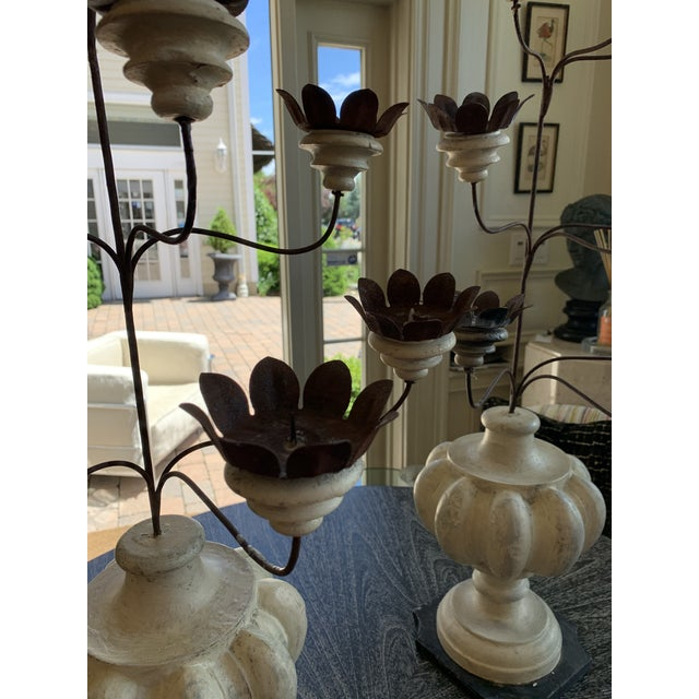 These candelabrums are made of distressed turned wood on a square base with nine candle holders each. Perfect for a dining...