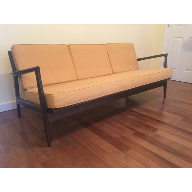 Danish mid-century modern sofa by Ib Kofod Larsen. Completely restored with new upholstery and foam. Straps in perfect...