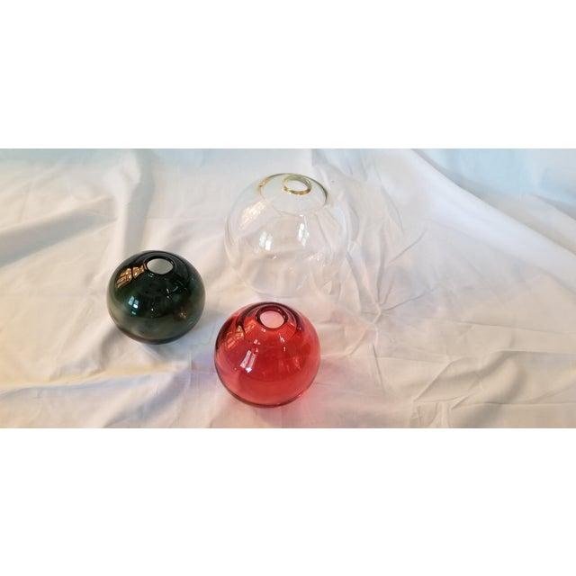 "Sklo float vessels small- 4"" dia. in smoke small- 4"" dia. in red medium- 6"" dia. in champagne"