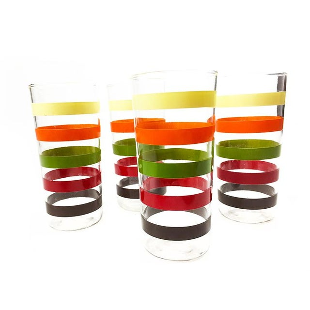 Vintage set of 4 retro high ball glasses with colorful stripes. The glass is in great condition with fun, extremely retro,...