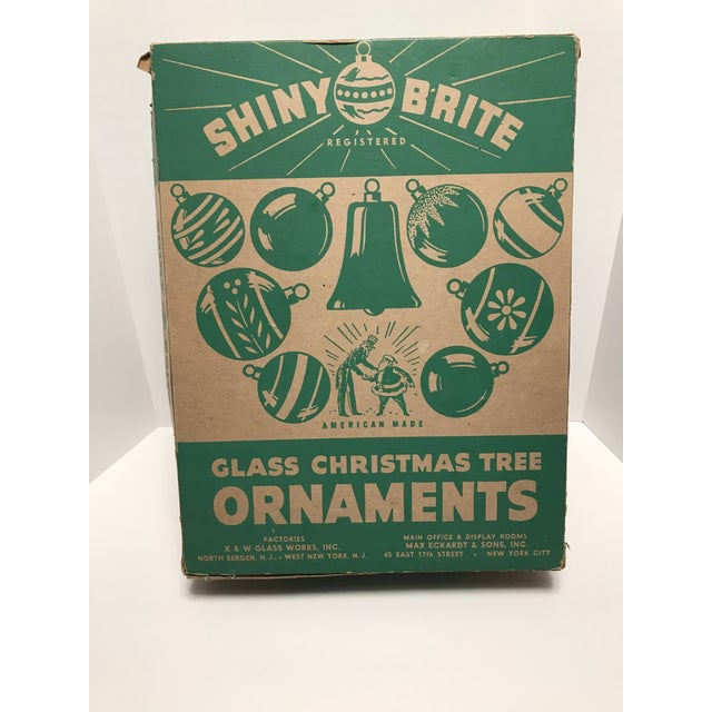 14 beautiful 1950s glass ornaments with vibrant colors and patterns! Comes in original Shiny Brite box. These are pre-...