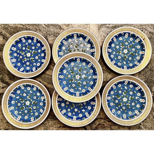 Rare set of 7 Wedgwood plates in a slightly Asian floral motif with cherry blossoms and a gilt Greek key design on the...