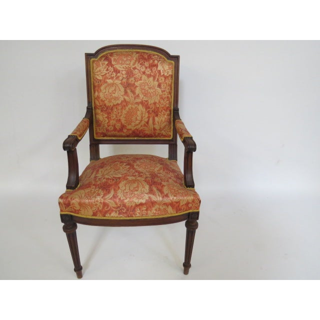Beautiful Walnut chair from around the early 1900's. The chair is a straight back, with arms and legs in a carved fluted...