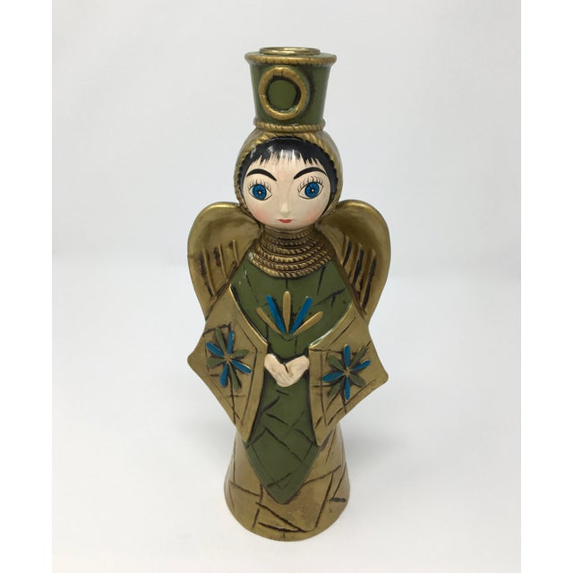 Paper Mâché objet d'art were common in the 1960s and early 70s. This blue, green and gold angel from the early 70s is a...