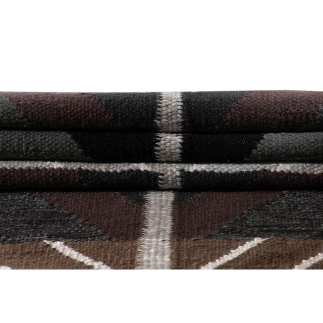 Beautiful Contemporary Swedish Style Rug with a gray field and multi-colored accents with an all-over geometric design....