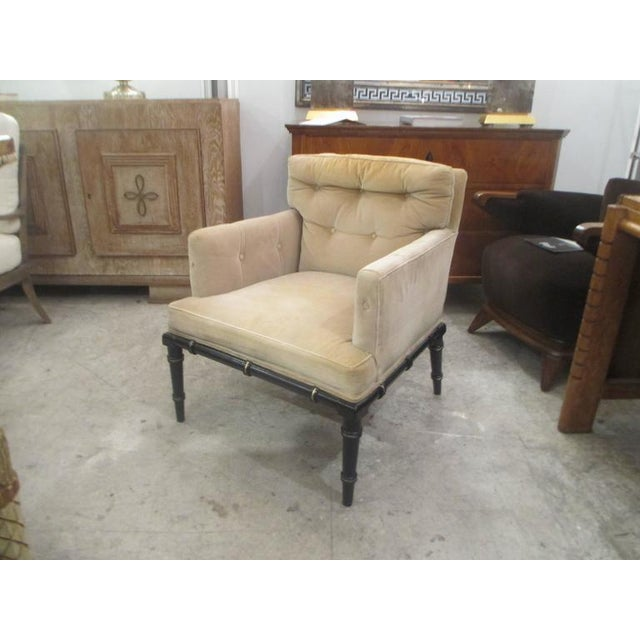 Pair of vintage upholstered and ebonized faux-bamboo armchairs.