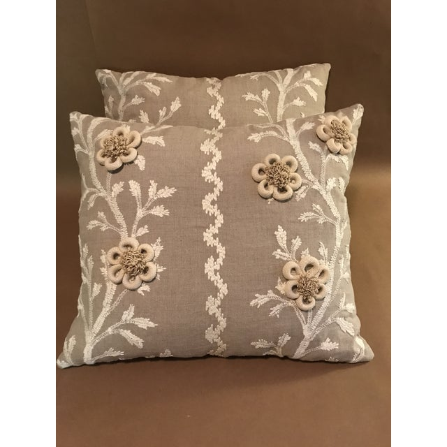 """A pair of Brunschwig & Fils Ppillows in """"Sea Vine"""" color wheat. White embroidered vines on Linen decorated with handmade..."""