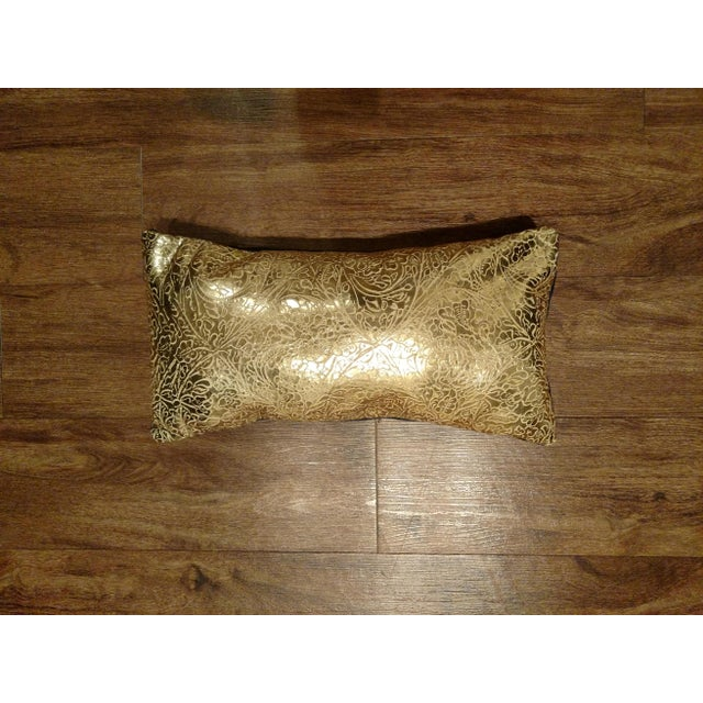 New showroom display model. Gold leather pillow with blue velvet on back. Zipper closure. Made in USA 100% Polyfiber filled.