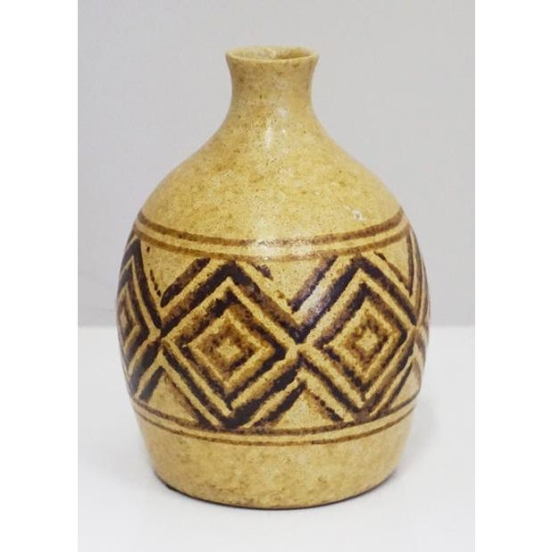 A weed pot is any vessel holding a small amount of foliage. This has a geometric pattern with some horizontal lines.