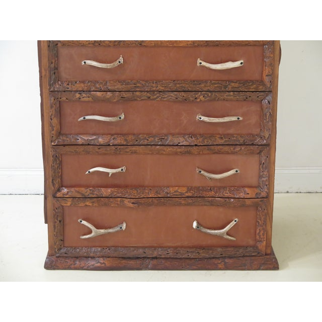 Unique adirondack style 6 drawer high chest. Features faux antler hardware, leather top, drawer fronts & side panels. See...