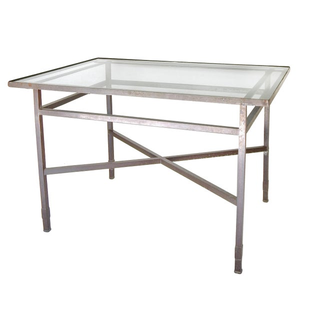 Elegant brass table base with glass top - clean lines.