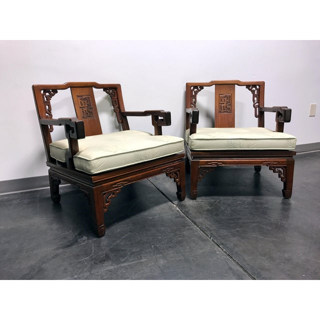 """A pair of Asian Style Carved Mahogany Lounge Chairs. Made in Korea. Carved mahogany frames. Marked """"Korea Furniture Mfg...."""