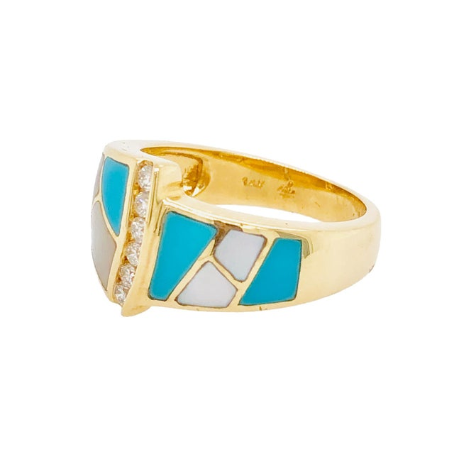 A fabulous vibrantly colored inlaid ring in 14K yellow gold designed by Ash Grossbardt. The ring has Persian turquoise,...