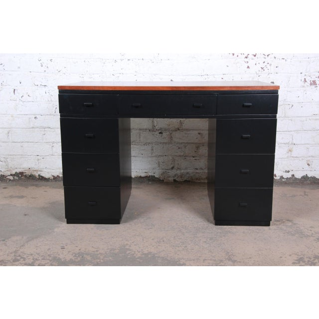 An exceptional newly restored kneehole desk by Edward Wormley for Dunbar Furniture. This is a rare surviving piece of...