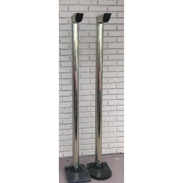 Gorgeous pair of rare mid-century modern floor lamps. Color gold on black marble vase. Has 2 set of lights, top of lamp...