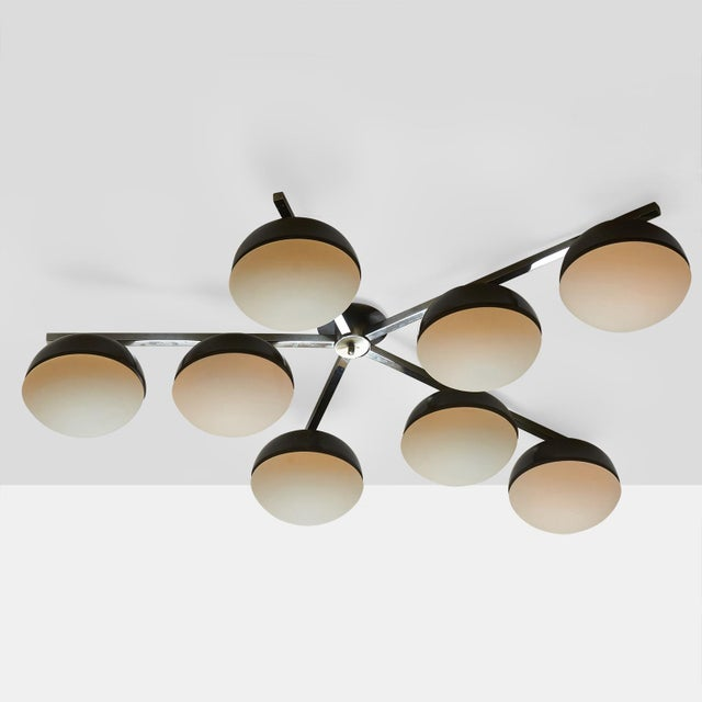 Dominici Chandelier A large-scale flush mount ceiling or wall fixture designed by Dominici in Brazil circa 1960s with...