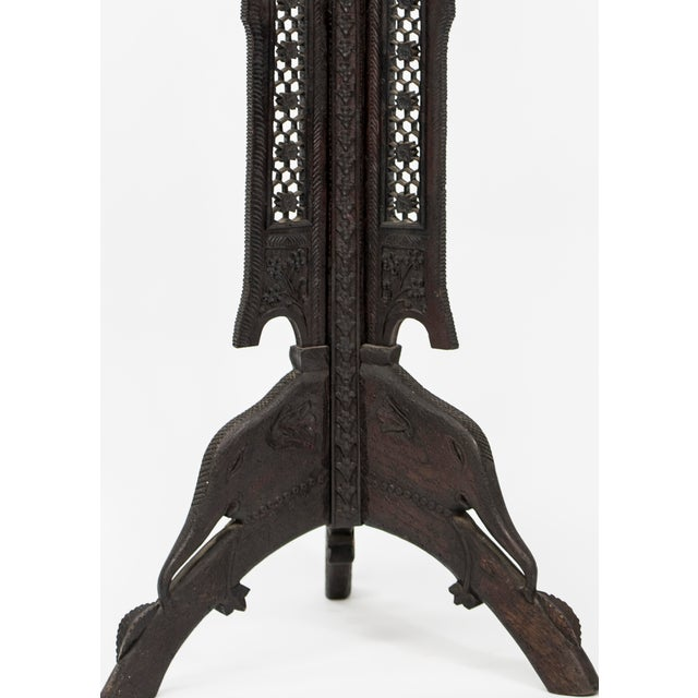 Intriguing, finely carved, hardwood Anglo Indian pedestal with a hexagonal top and scalloped skirt over an architectural...