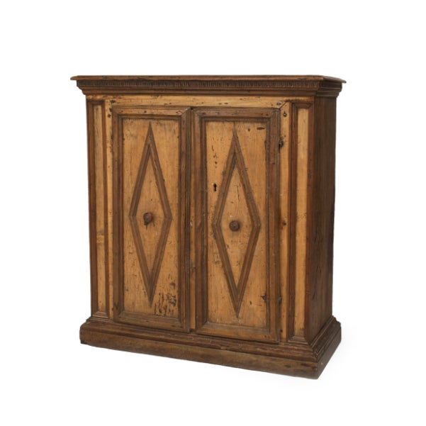 Italian Renaissance (Tuscan, late 17th century) walnut cabinet having two doors with a diamond design.