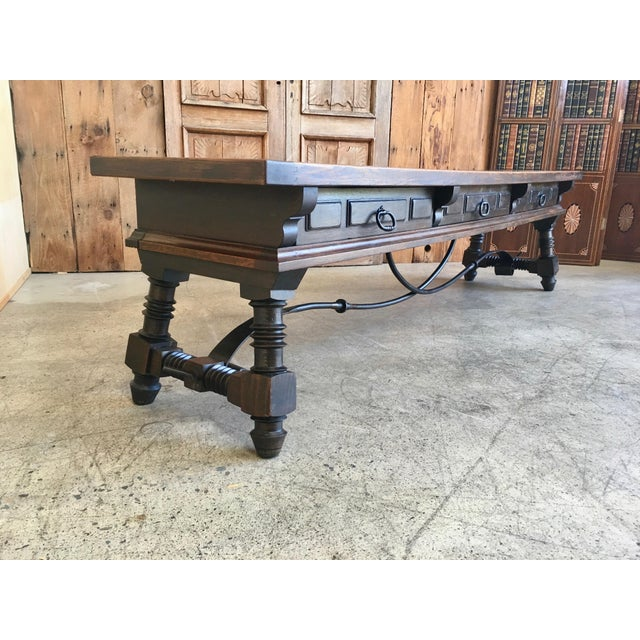 Antique massive oak sideboard long and low with three drawers and steel stretcher spanning the legs. Made in the early...