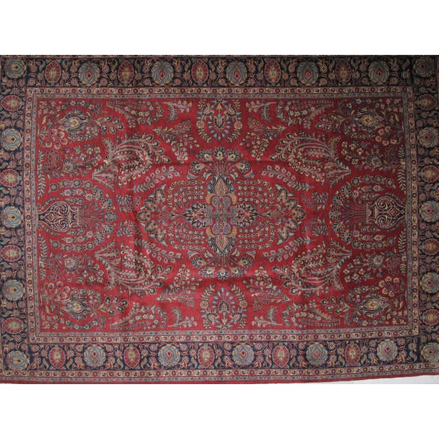 Wool pile hand woven antique red Persian Tabriz carpet in excellent condition.
