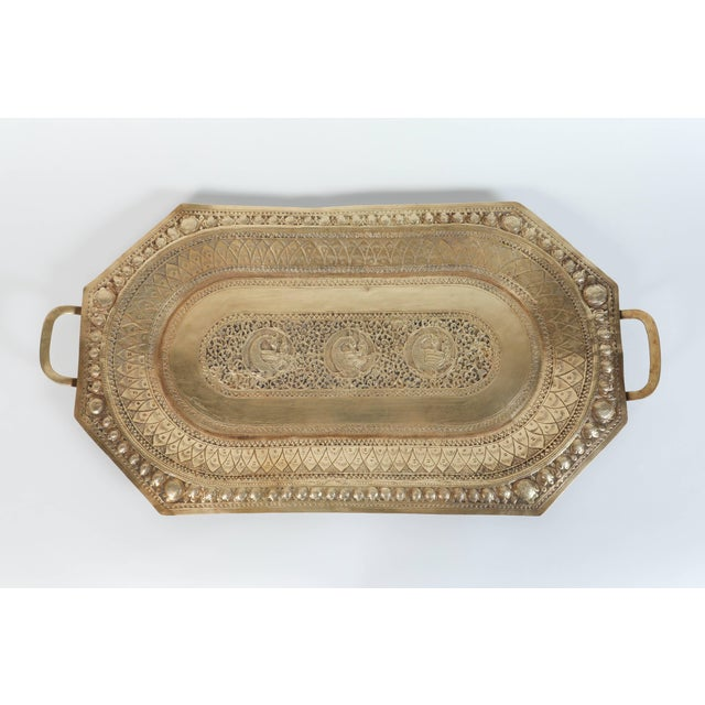 A large Mamluk revival Indo Persian brass charger serving tray with handles. Large octagonal serving tray engraved and...