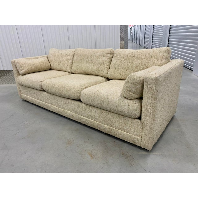 1970s tuxedo sofa. The sofa stands on four rolling casters so very easy to maneuver. The sofa comes with a total of eight...